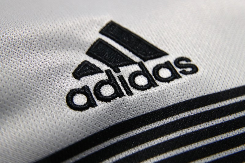 An Adidas sign is seen before the company's annual news conference in Herzogenaurach