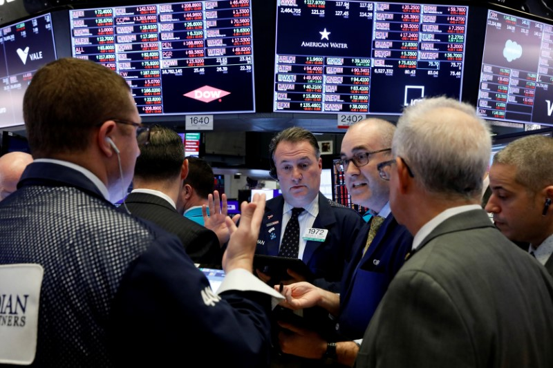Traders work on the floor of the New York Stock Exchange (NYSE) near the close of trading in New York