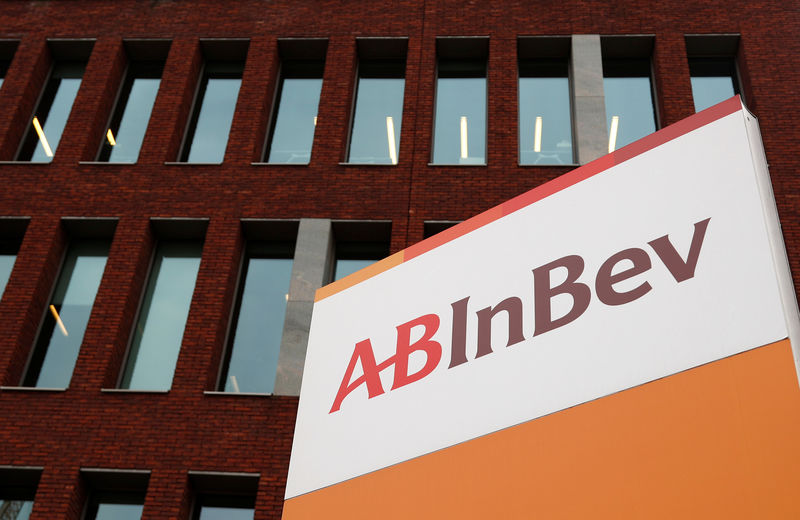 FILE PHOTO: The logo of AB InBev is pictured outside the brewer's headquarters in Leuven