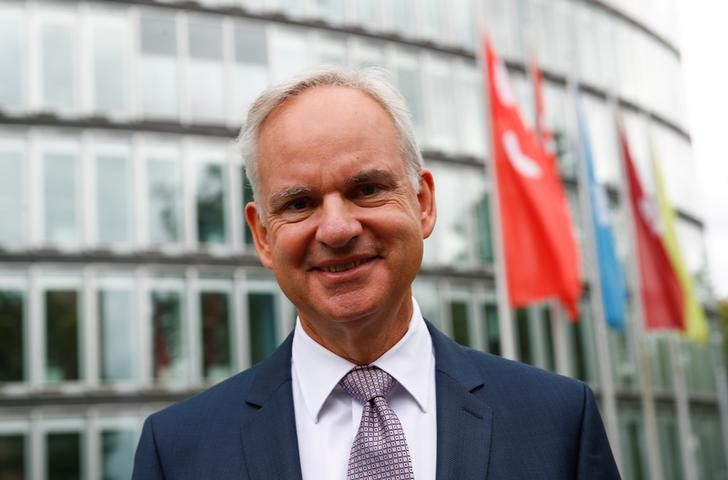 E.ON CEO Johannes Teyssen poses in front of the E.ON headquarters after a news conference in Essen