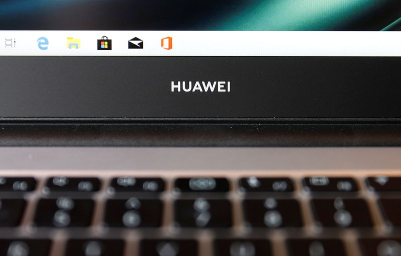 FILE PHOTO: A Huawei logo is seen on a device at a media event in London