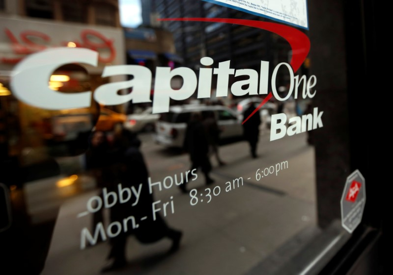 FILE PHOTO: People walk past a Capital One banking center in New York's financial district
