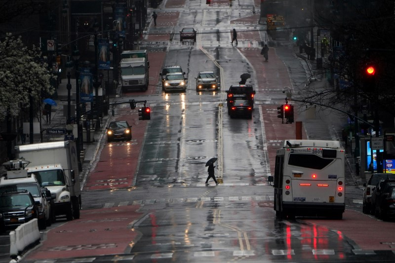 Person crosses a mostly deserted 42nd Street in Manhattan