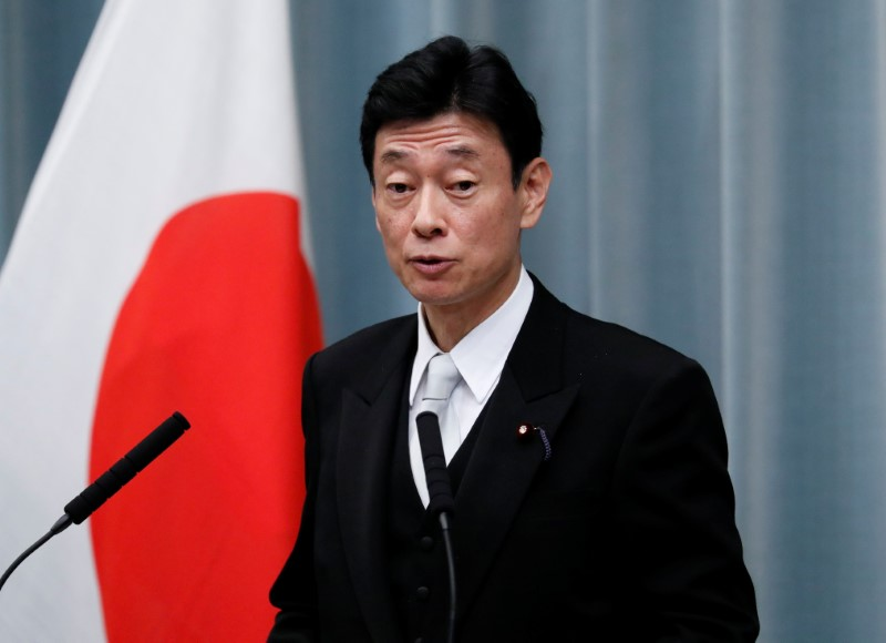 Japan's Economy Minister Nishimura attends a news conference at PM Abe's official residence in Tokyo