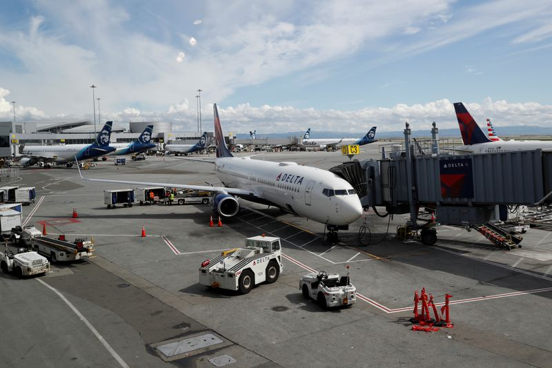 Planes are seen parked at gates at San Francisco International Airport