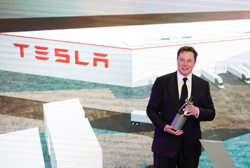 FILE PHOTO: Tesla Inc CEO Elon Musk attends an opening ceremony for Tesla China-made Model Y program in Shanghai