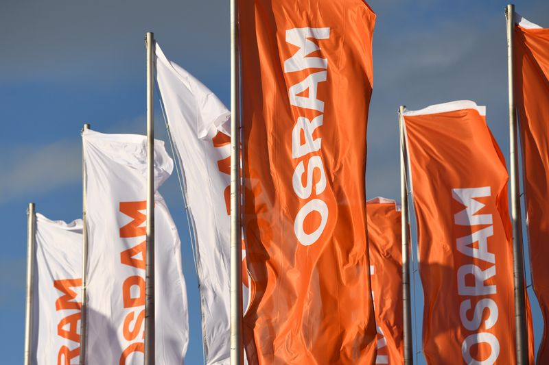 Flags with the logo of German lighting manufacturer Osram Licht AG blow in the wind in Munich