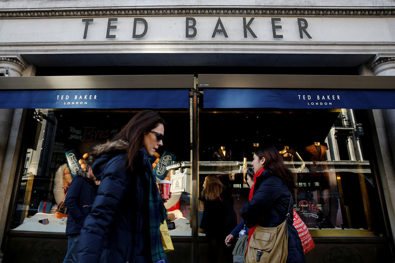FILE PHOTO: Shoppers walk past a Ted Baker store on Regents Street in London