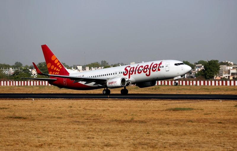 FILE PHOTO: A SpiceJet Boeing 737 passenger aircraft takes off from Sardar Vallabhbhai Patel international airport in Ahmedabad