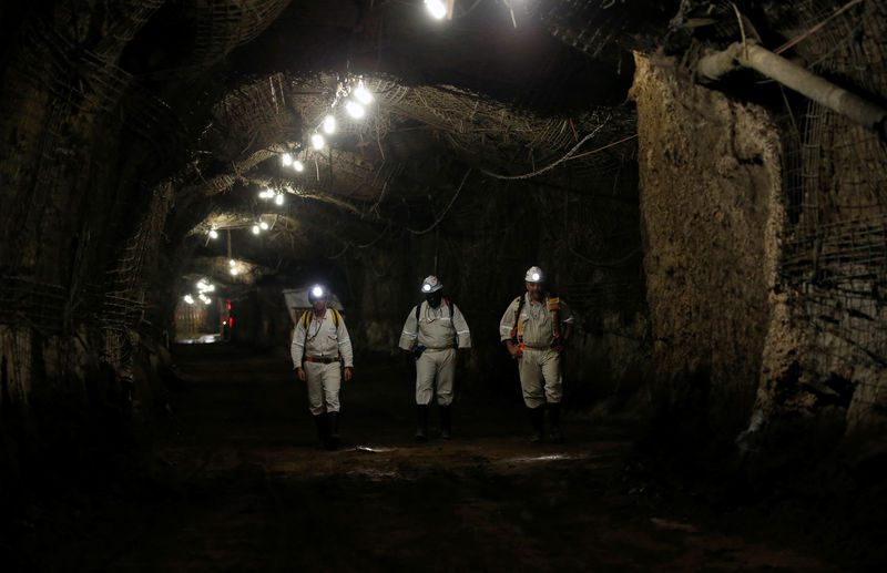 Workers are seen underground South Africa's Gold Fields South Deep mine in Westonaria