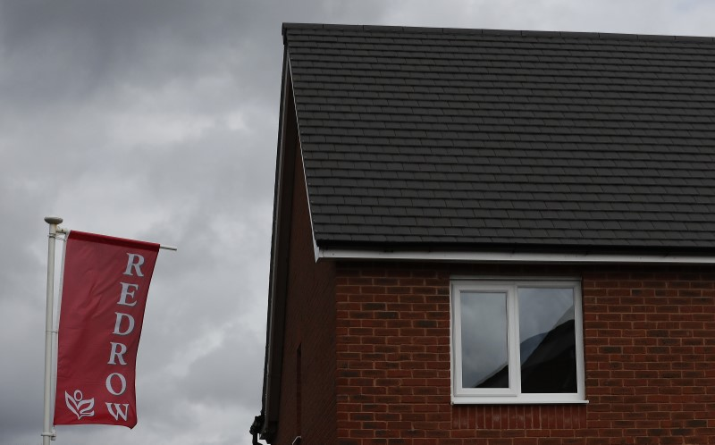 The company logo of construction company Redrow is pictured on a flag at a new housing development near Manchester northern England.