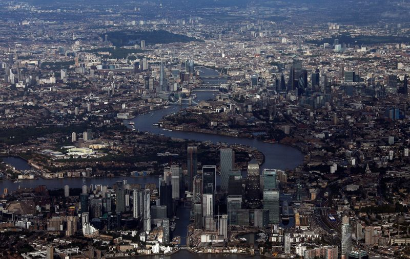 FILE PHOTO: Canary Wharf and the City of London financial district are seen from an aerial view in London