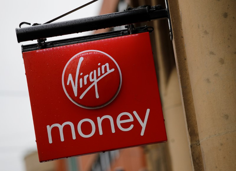 Signage is seen outside a branch of Virgin Money in Manchester