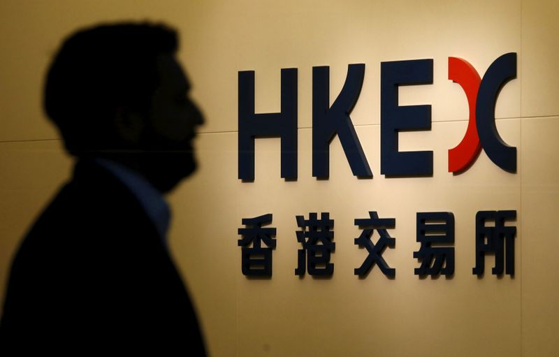 A man walks past the entrance to the Hong Kong Exchanges in Hong Kong