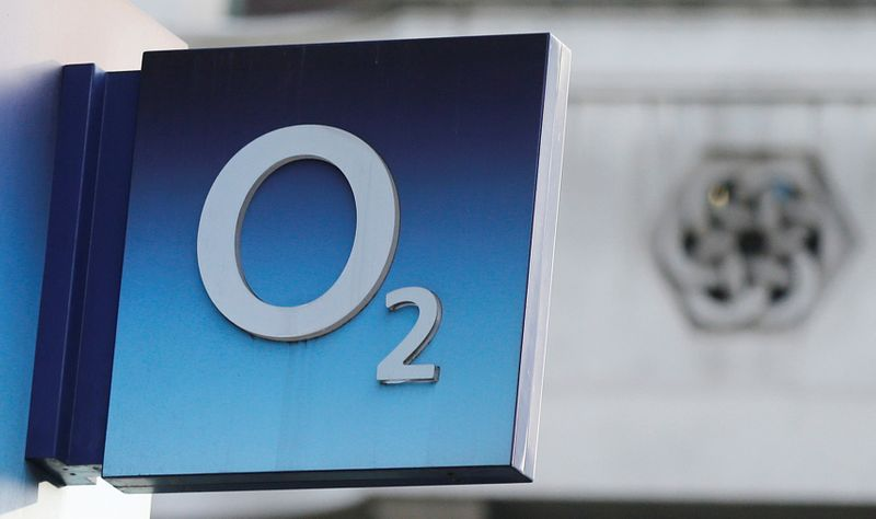 FILE PHOTO: A sign hangs outside an O2 mobile phone shop in central London