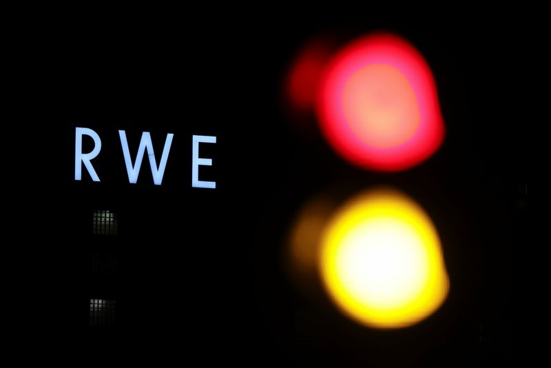The logo of German utility and and energy supplier RWE is pictured next to a traffic light outside RWE's lignite power plant in Weisweiler near the western German city of Aachen