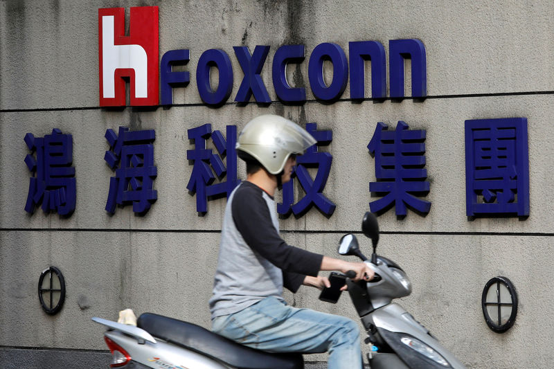 Record Foxconn profit fall as virus guts smartphone demand