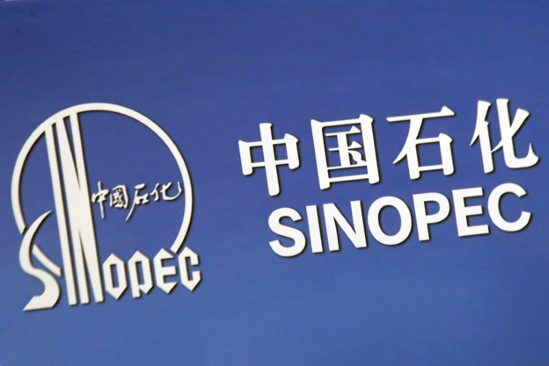 FILE PHOTO: The company logo of China's Sinopec Corp is displayed at a news conference in Hong Kong