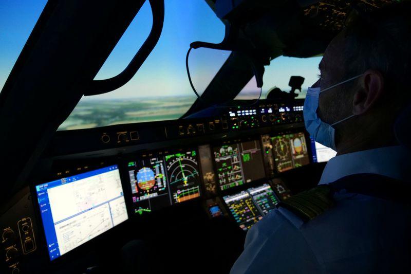 An Air France pilot trains in a flight simulator at a training centre near Paris amid COVID-19 outbreak