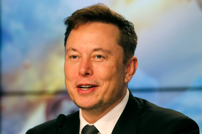 FILE PHOTO: SpaceX founder and chief engineer Elon Musk speaks at a post-launch news conference to discuss the  SpaceX Crew Dragon astronaut capsule in-flight abort test at the Kennedy Space Center