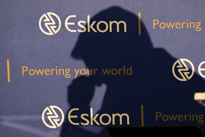 The shadow of new Chief Executive of state-owned power utility Eskom Andre de Ruyter is seen as he speaks at a media briefing in Johannesburg