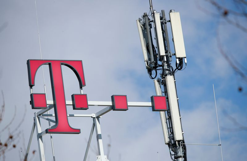 FILE PHOTO: Logo of German telecommunications giant Deutsche Telekom AG and GSM antennas are seen atop of the headquarters of Deutsche Telekom in Bonn