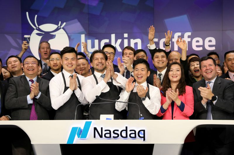 FILE PHOTO: Jenny Qian Zhiya CEO of Luckin Coffee and employees ring the opening bell to celebrate the company's IPO at the Nasdaq Market site in New York