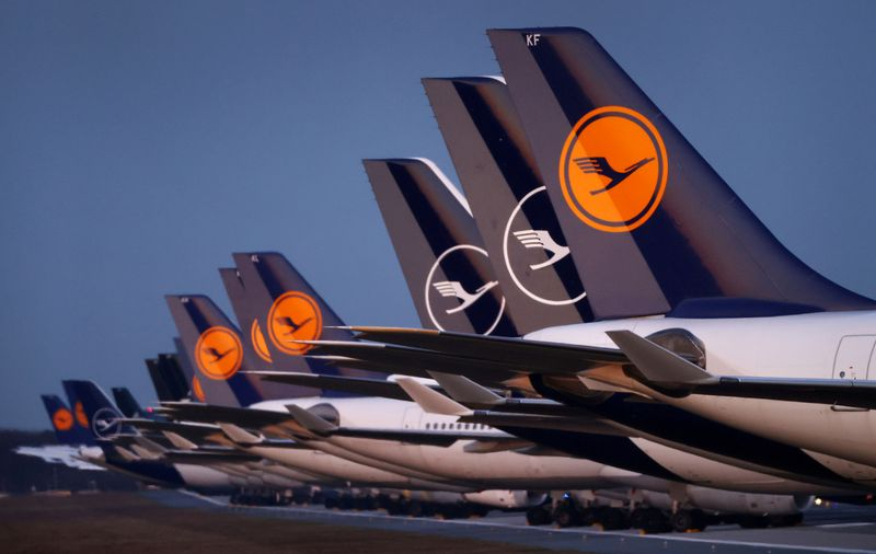 FILE PHOTO: Planes of German carrier Lufthansa are parked on a closed runway in Frankfurt