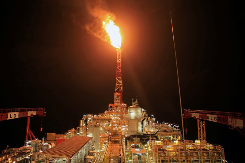 FILE PHOTO: Kaombo Norte floating oil platform is seen at night off the coast of Angola