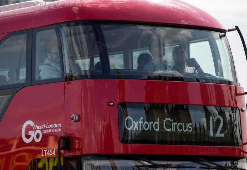 FILE PHOTO: A Go Ahead bus crosses Westminster Bridge in London