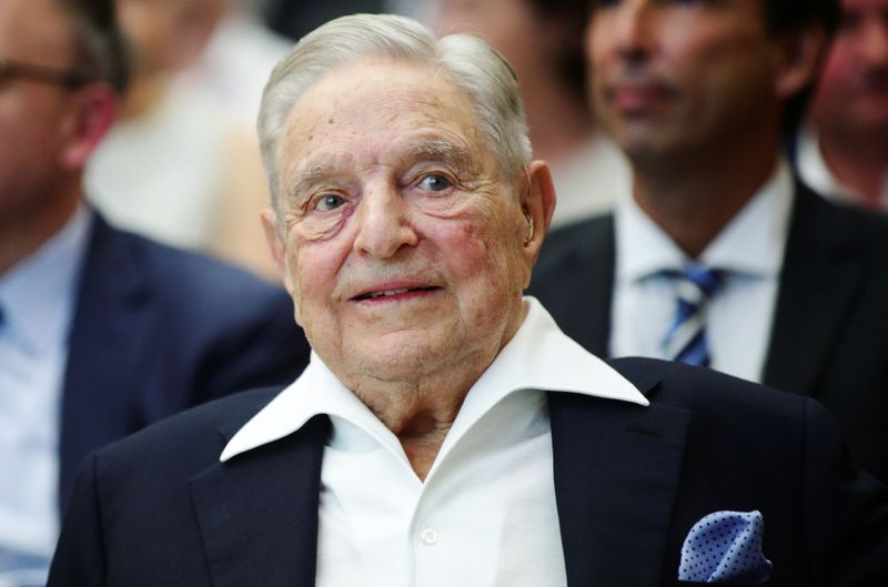 FILE PHOTO: Billionaire investor George Soros is awarded the Schumpeter Prize, an Austrian award for achievement in economics and politics, in Vienna, where the Central European University he funds is opening a new campus after being forced out of hi