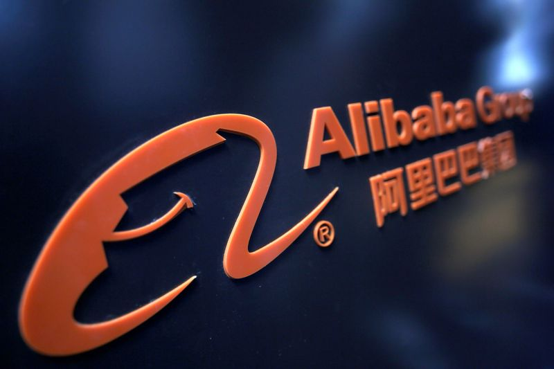 FILE PHOTO: A logo of Alibaba Group is seen at an exhibition during the World Intelligence Congress in Tianjin