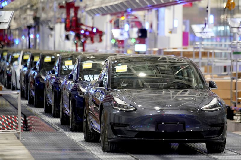 FILE PHOTO: Tesla China-made Model 3 vehicles are seen during a delivery event at its factory in Shanghai
