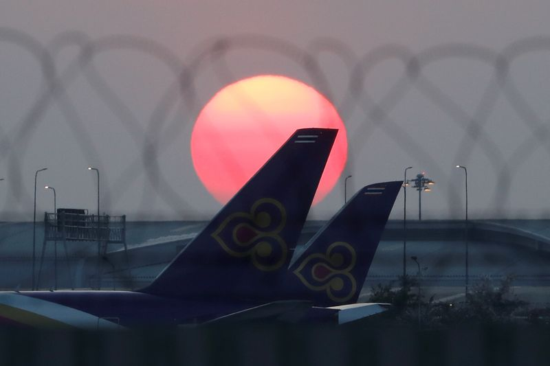 FILE PHOTO: Thai Airways airplanes are parked at the tarmac of Suvarnabhumi Airport in Bangkok
