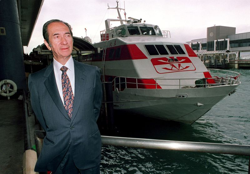 FILE PHOTO:  Hong Kong tycoon Stanley Ho looks out from the Macau Ferry Terminal