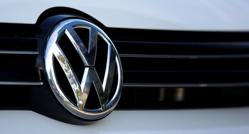 FILE PHOTO: The logo of German car maker Volkswagen is seen on a car outside a garage in Vienna
