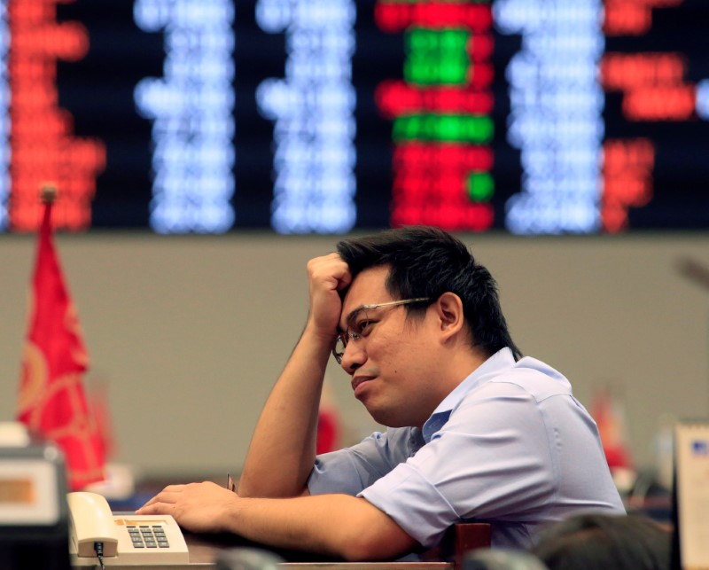 A trader reacts during trading at the Philippine Stock Exchange in Makati city, Metro Manila