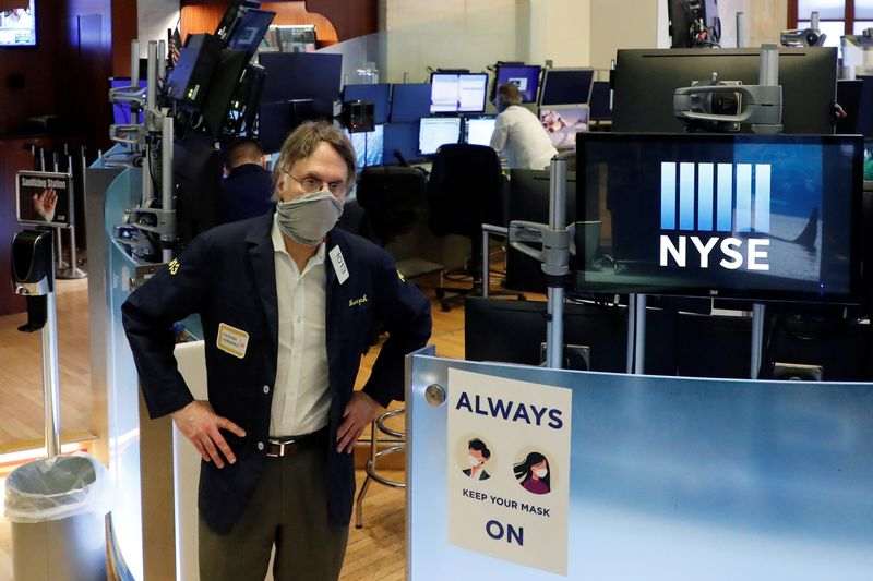 FILE PHOTO: Traders on the floor of the New York Stock Exchange during the coronavirus outbreak, USA