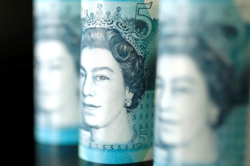 FILE PHOTO: British five pound banknotes are seen in this picture illustration
