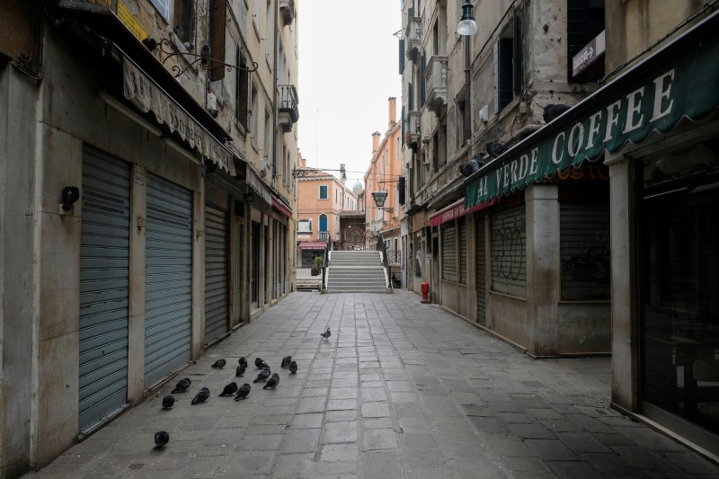 FILE PHOTO: Streets are seen virtually deserted in Venice as the Italian government continues restrictive movement measures to combat the coronavirus outbreak, in Venice