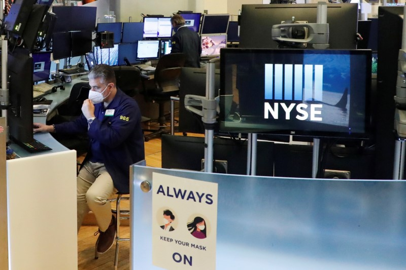 Wall Street mixed as investors weigh spike in virus cases