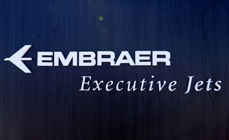 FILE PHOTO: A logo of Business jets maker Embraer Executive Jets is pictured on their booth during EBACE in Geneva