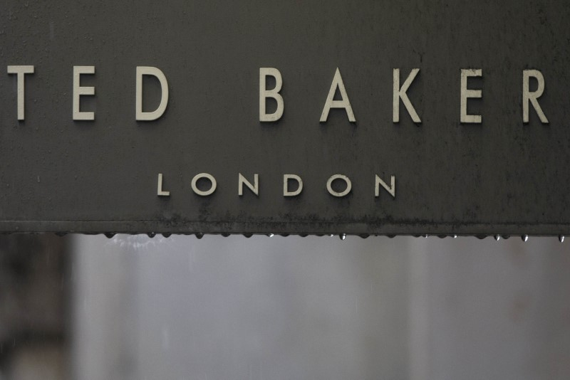FILE PHOTO: Rain drips off a sign on a Ted Baker sign on a store in London, Britain