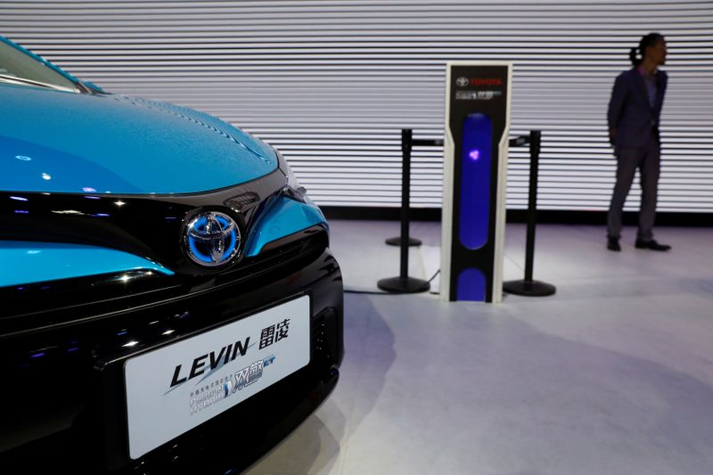 A Toyota Levin plug-in hybrid vehicle is displayed during a media preview of the Auto China 2018 motor show in Beijing