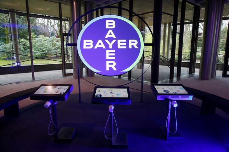 FILE PHOTO: The logo of Bayer AG is seen in a showroom of the German drugmaker where the annual results news conference takes place in Leverkusen