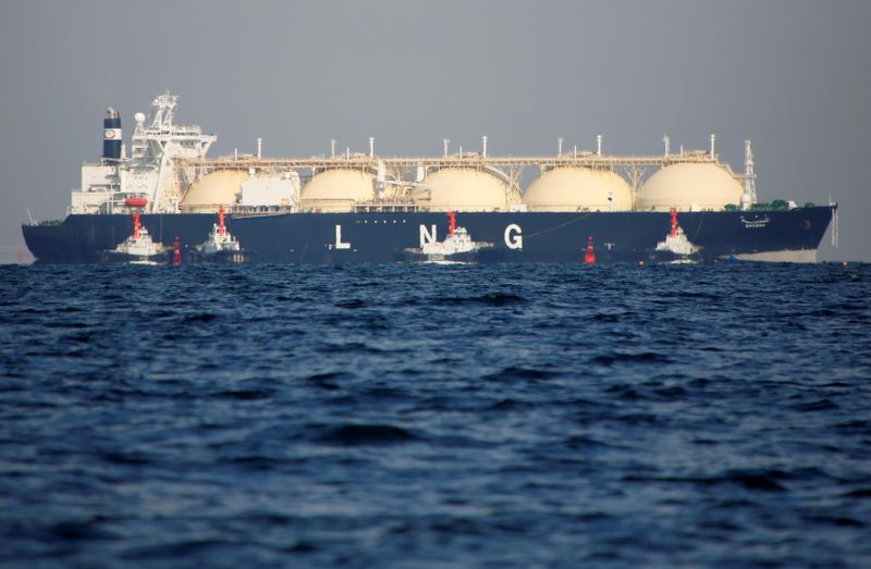 FILE PHOTO: A LNG tanker is tugged towards a thermal power station in Futtsu