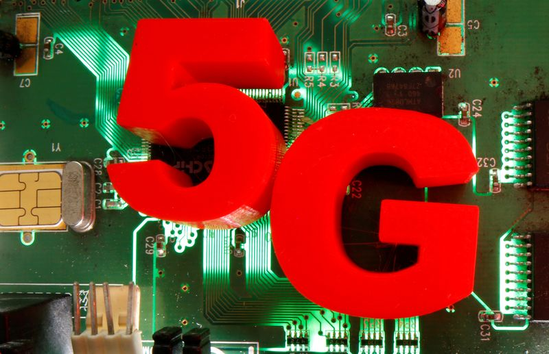 FILE PHOTO: 3D-printed objects representing 5G are put on a motherboard in this picture illustration