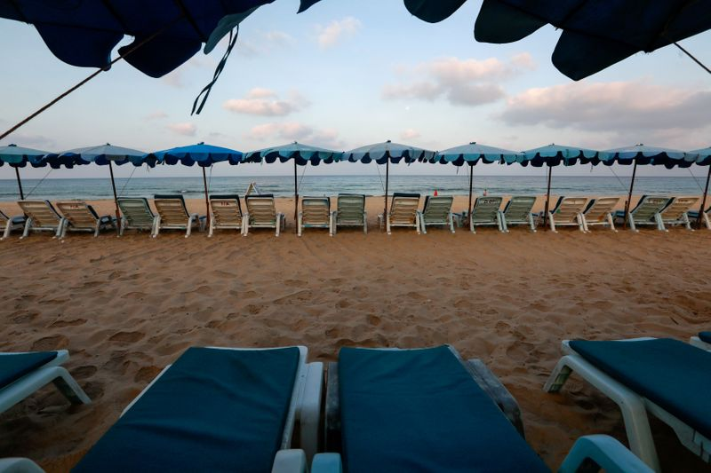 FILE PHOTO: Empty chairs are seen on a beach which is usually full of tourists, amid fear of coronavirus in Phuket