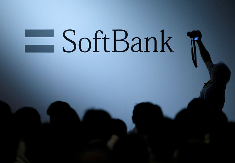 FILE PHOTO: The logo of SoftBank Group Corp is displayed at SoftBank World 2017 conference in Tokyo