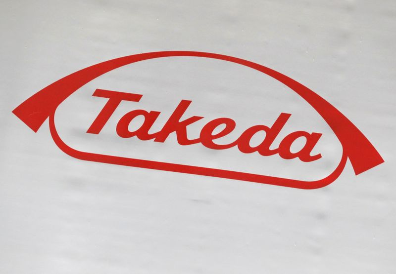 FILE PHOTO: The logo of Takeda Pharmaceutical Co. is displayed at the company's news conference venue in Tokyo